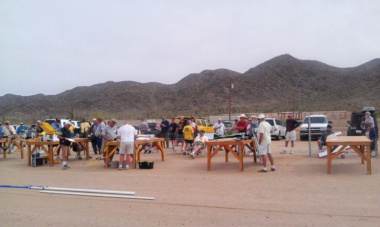 Club members getting ready for a fun fly event. The poles seen on the ground are used for the limbo contest and for pylon races.