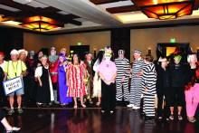 Bingo players in scary costumes for Boo Bingo.