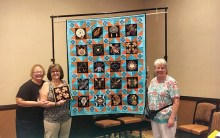 Pictured from left to right: Robin Tisinger, Diane Williams, Marie Stuersel. Robin and Marie, along with Patty Foley and 2019 Raffle Quilt Chair Sharon Haworth, embroidered the quilt blocks. Sewing the blocks together and machine quilting was completed by Sharon Haworth.