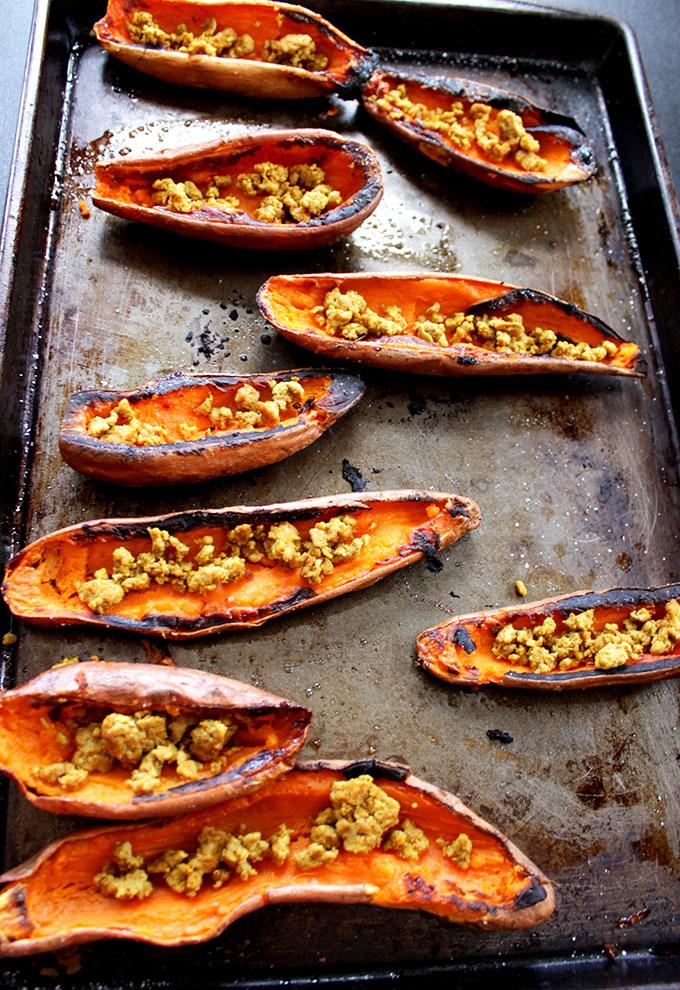 Coconut Quinoa Stuffed Sweet Potato Boats with Cilantro Lime Cashew Sauce. Bursting with flavor.
