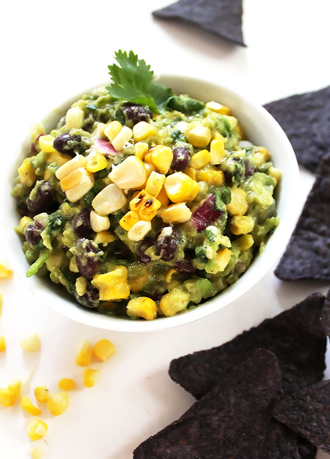 Grilled Corn and Black Bean Guacamole. Only requires 8 ingredients. Simple to make. Screams summer! #vegan #Glutenfree #guacamole | robustrecipes.com