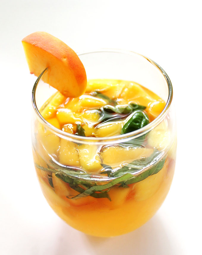 Peach Mango Sangria. Refreshing. Juicy and sweeet! Packed with fruit! #sangria #summercocktail #recipe | robustrecipes.com