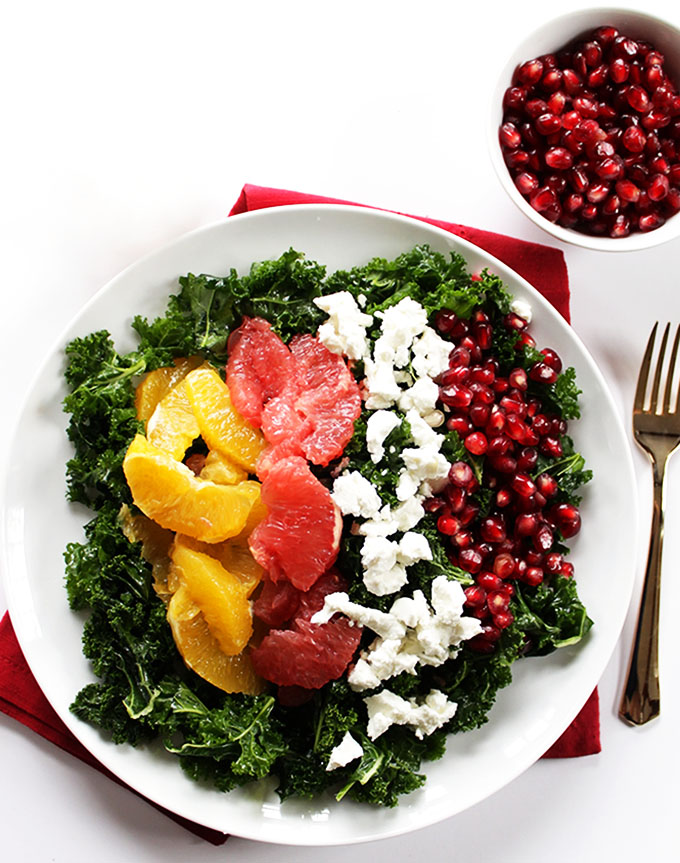 Winter Kale Salad. A healthy salad with cirtrus fruites, and pomegranates. Perfect as a side salad!
