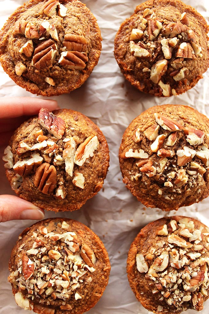 Spiced Carrot Muffins - Tender muffins packed with carrots, raisins, and topped with pecans. EASY to make! Gluten free/Dairy Free! | robustrecipes.com