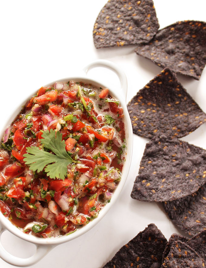 Grape Tomato Salsa - EASY fresh salsa made in a few minutes. Healthy ingredients: grape tomatoes, garlic, red onion, cilantro, jalapenos, and lime juice. SO TASTY! Vegan/Gluten Free. | robustrecipes.com