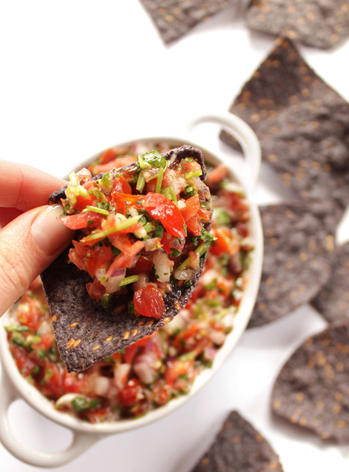Grape Tomato Salsa - EASY fresh salsa made in just a few minutes! Grape tomatoes, cilantro, red onion, jalapeno, garlic, lime juice. Plus plenty of chips for dipping! SO GOOD! Vegan/Vegetarian/Gluten Free. | robustrecipes.com