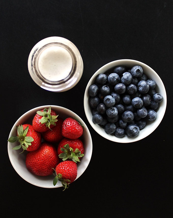Strawberries, blueberries, and coconut milk for Vegan Red White and Blue Popsicles. refined sugar free/gluten free/vegan.