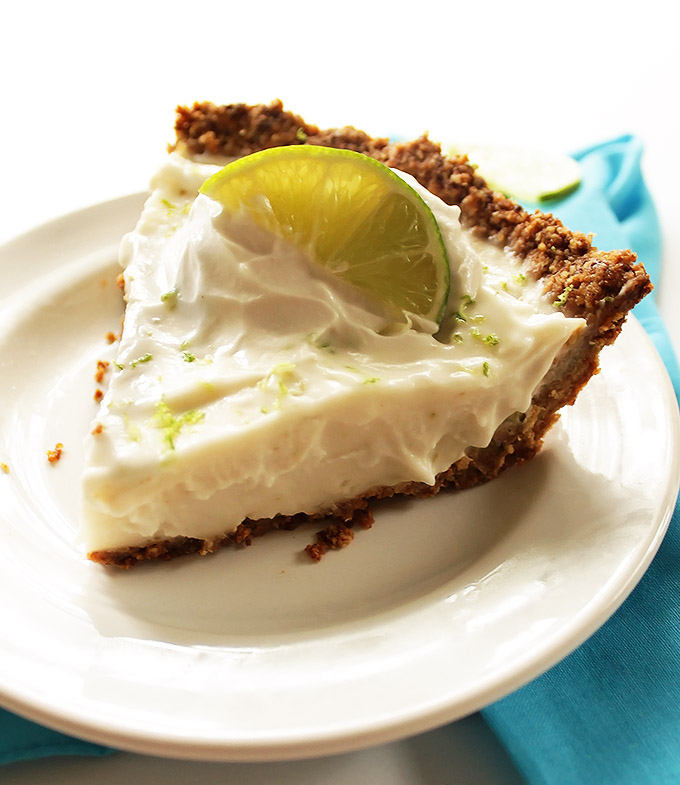 Gluten Free Key Lime Pie - Perfect balance of sweet and tart. creamy filling with a gluten free oat and almond crust. This dessert recipe is easy to make. It's the perfect summertime dessert! Vegan/Gluten free/ refined sugar free