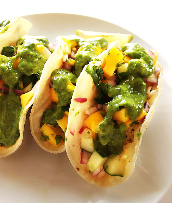 Fish Tacos with Cucumber Mango Pico De Gallo and Cilantro Sauce - Easy, healthy, summertime recipe that comes together in 20 minutes! Gluten free