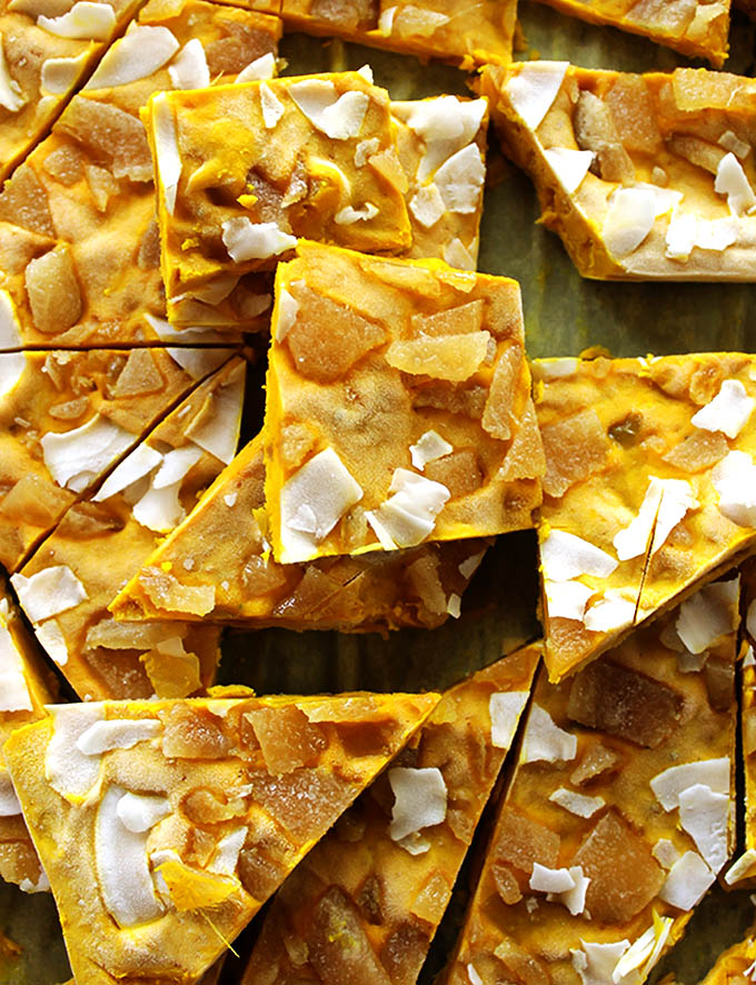 Golden Milk Frozen Yogurt Bark - Inspired by golden milk yogurt bark is packed with healthy turmeric. It's creamy, nutty, with a nice kick from crystallized ginger! This recipe is quick and EASY to make. Perfect for a summer snack! Gluten Free
