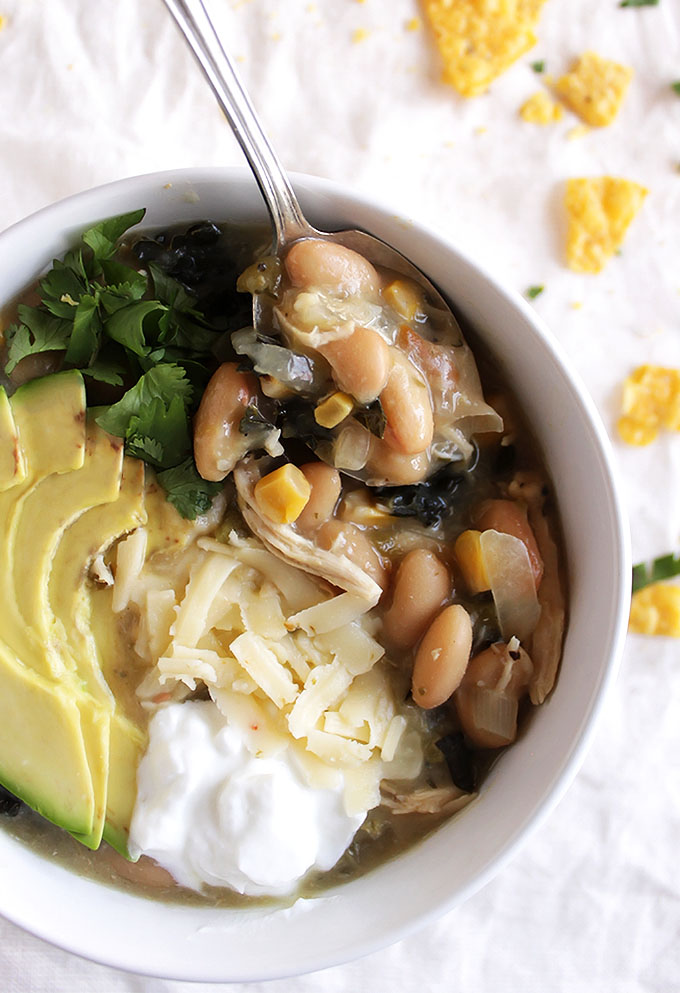 Slow Cooker White Chicken Chili - Comforting and warming. This recipe is super EASY to make thanks to the slow cooker! It makes a huge batch and freezes well! Perfect meal for cold evenings! Dairy free/gluten free | robustrecipes.com