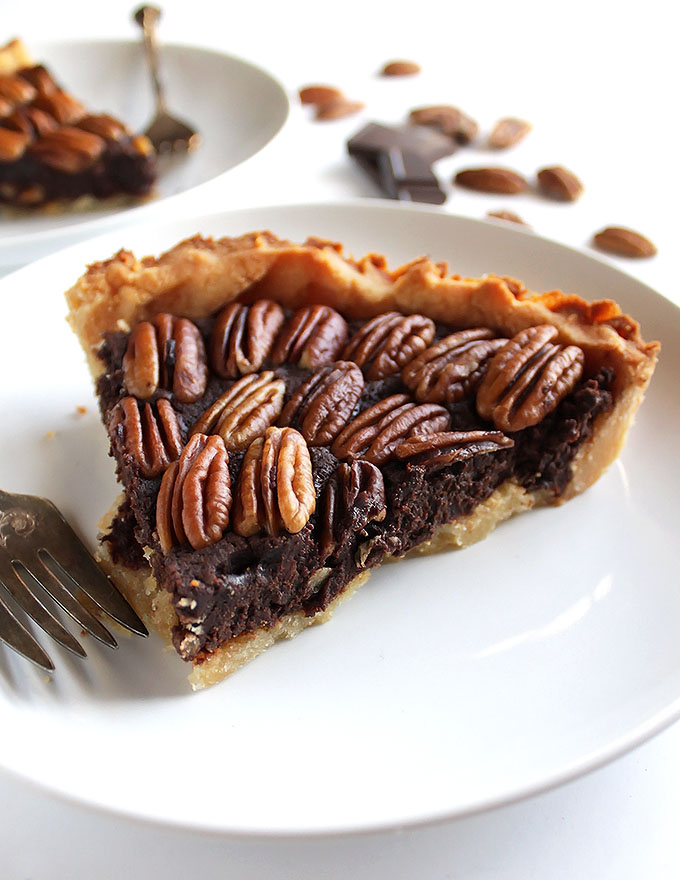 Gluten Free Chocolate Pecan Pie - Rich, fudgey filling with a doughy crust and toasted pecans! This recipe is easy to make and can be made days in advance! It doesn't contain any corn syrup! The perfect dessert for the Holidays! | robustrecipes.com