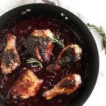 Marinated Cranberry Chicken - This recipe is easy enough for a weeknight dinner! Chicken pieces with crispy skin and a tart cranberry sauce! Serve it with your favorite grain! So Yum! Gluten Free | robustrecipes.com