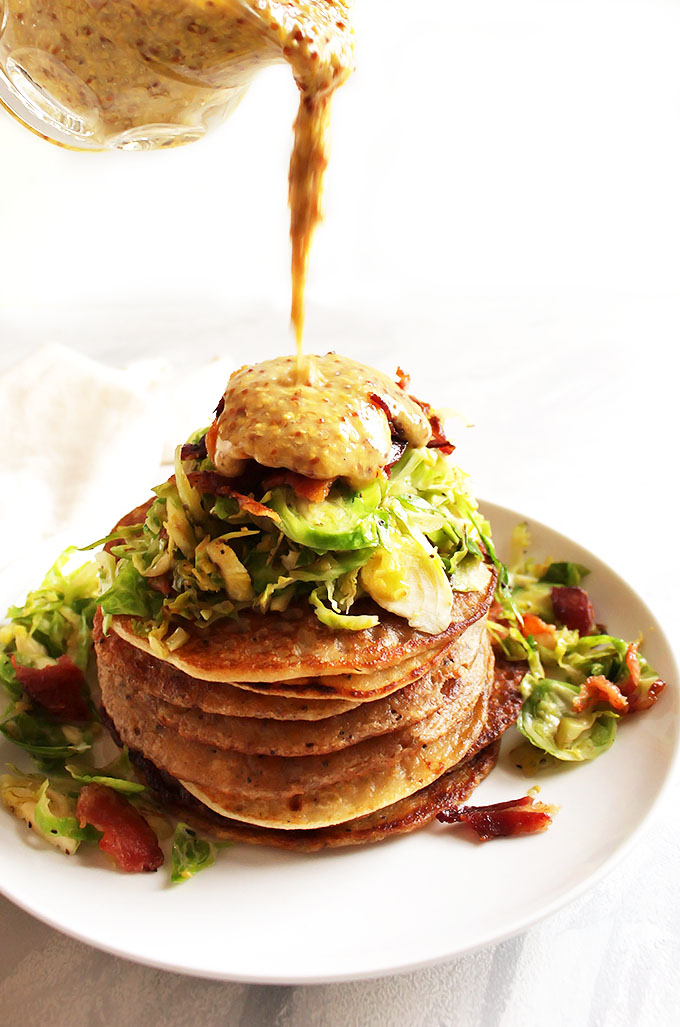 Irish Boxty Potato Pancakes with Brussels Sprouts and Bacon - Tender, fluffy pancakes topped with warmed shredded Brussels sprouts, crispy bacon, and a honey mustard sauce! This recipe is based off a traditional Irish recipe. Perfect for St. Patrick's day or a brunch party!!! Gluten Free | robustrecipes.com