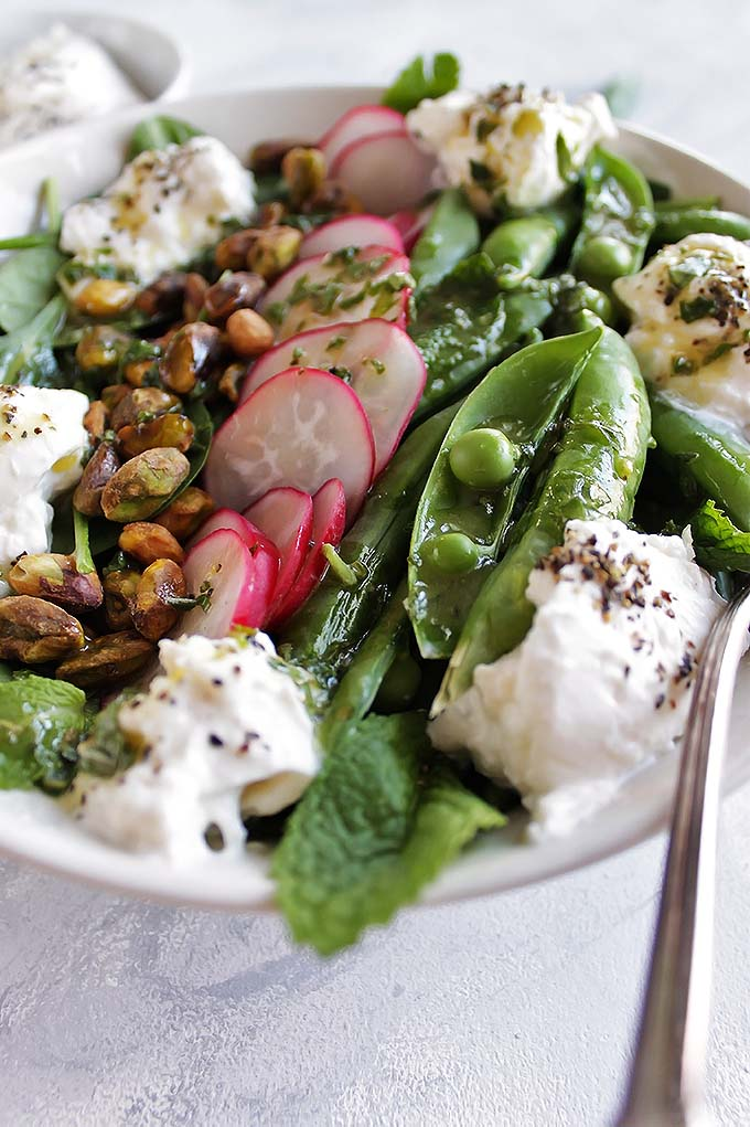 Simple Spring Salad with Sugar Snap Peas and Burrata - a refershing salad loaded with veggies and drizzled with a lemon herb vinagrette! Perfect recipe for a side salad! Gluten Free/Vegetarian | robustrecipes.com