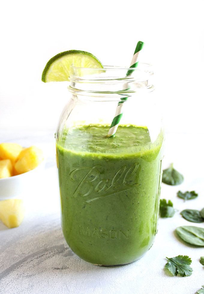 Super Green Pineapple Lime cilantro Smoothie - Refreshing, sweet, and tangy. This recipe is packed with detoxifying ingredients and antioxidants: spinach, pineapple, ginger, lime, bananas, cilantro. This smoothie recipe is one of our favorites!!! Vegan/Gluten Free/Dairy Free/Refined sugar free | robustrecipes.com