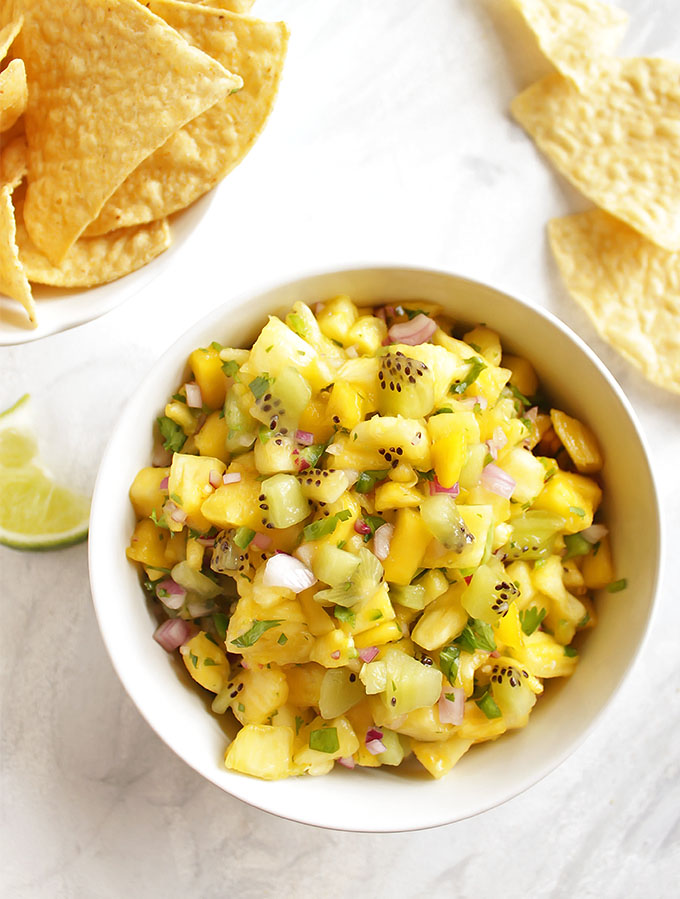 Tropical Fruit Salsa - A quick and flavorful fruit salsa that's a lot of sweet and a little savory. This recipe only requires 7 ingredients and 10 minutes to make! It goes great with tortilla chips for dipping or is delicious added on top of plain chicken, fish, or pork. It is even good on fish tacos! Gluten Free/Vegan/Vegetarian | robustrecipes.com