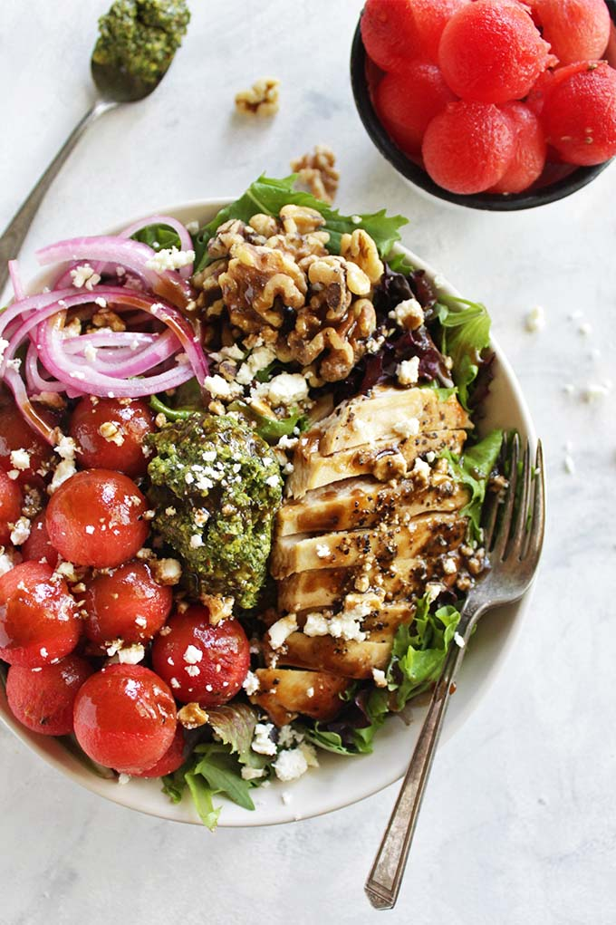 Loaded Watermelon Salad with Pesto - An entree salad loaded with sweet, juicy watermelon, basil pesto, pickled red onions, walnuts, pan seared chicken, feta cheese and a balsamic vinaigrette. It's the perfect balance of sweet and savory. This recipe is perfect for weeknight dinners! (Gluten Free) | robustrecipes,com