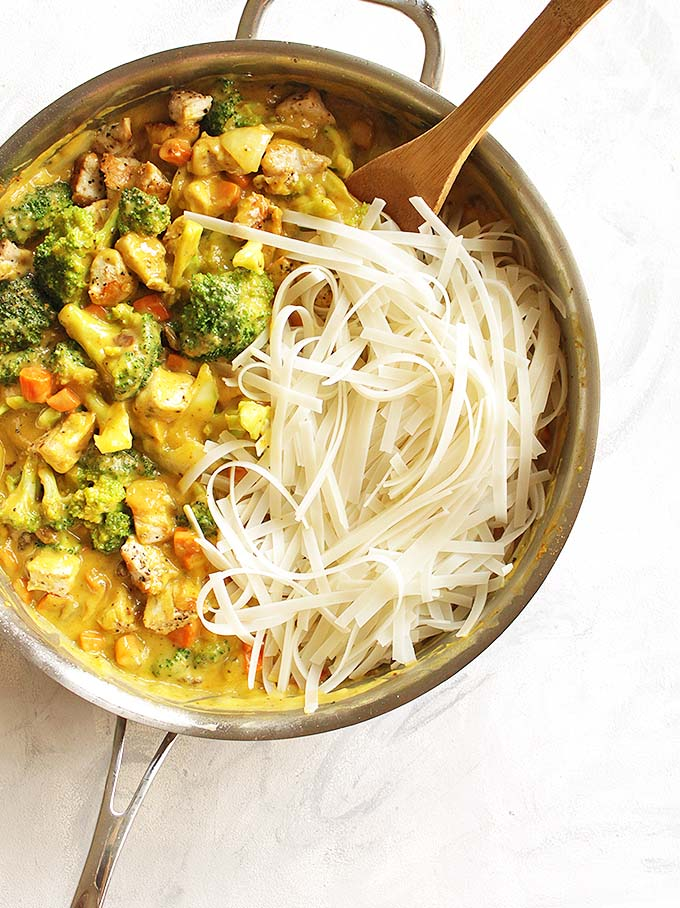 Mango Coconut Curry Chicken with Rice Noodles - A sweet and savory mango coconut curry sauce with chicken, rice noodles, broccoli and carrots. A great weeknight meal and the leftovers are perfect for lunch the following day. We love this recipe in the fall! Gluten Free/Dairy Free. | robustrecipes.com