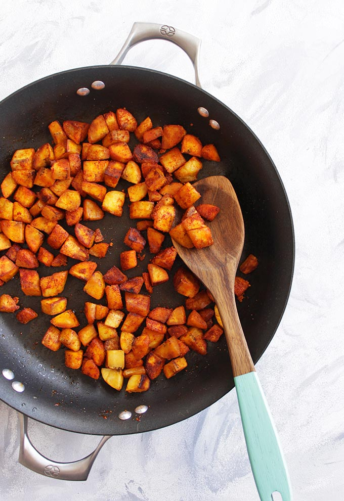 30 Minute Plantain Breakfast Hash with Runny Eggs - Loaded with savory veggies, smoked paprika, and slightly sweet and starchy plantains. All of that is topped with a runny egg! Only requires 1 pan and 30 minutes! The perfect weekend breakfast! (Gluten Free & vegetarian) | robustrecipes.com