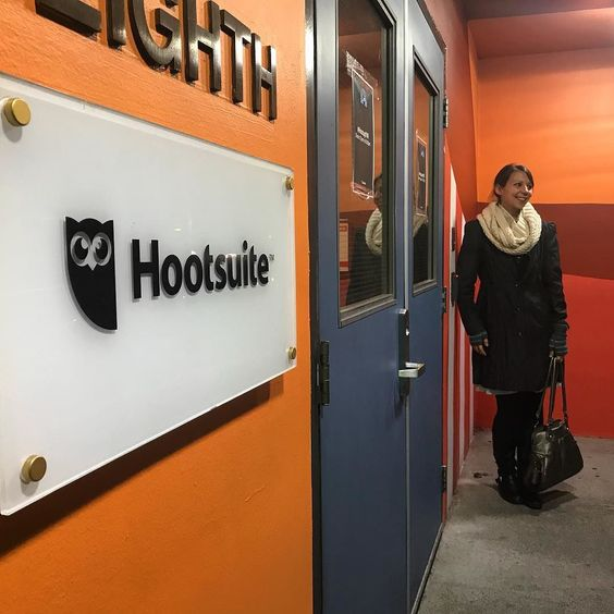 Robyn Roste standing outside Hootsuite headquarters in Vancouver, BC Canada