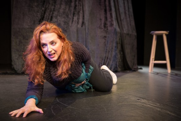 Alison (Suanne Braun) after her ordeal, in terror and heavily bleeding, drags herself to help. Photograph by Philip Kuhn.