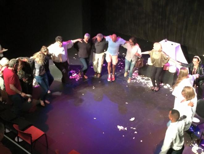Teaching them to dance: Renos Spanoudes (in a white shirt) gets his audience onstage, throwing plates and dancing. Photograph courtesy Buz Publicity
