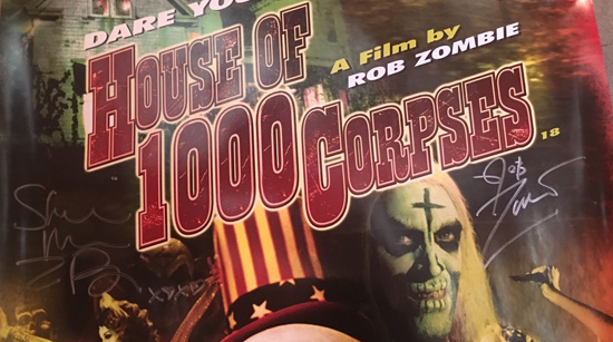 An original rare English HOUSE OF 1000 CORPSES poster signed by both ROB ZOMBIE and SHERI MOON ZOMBIE.
