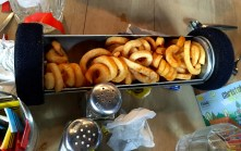Curly fries delivered via pneumatic tube