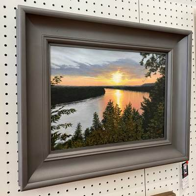 artwork of the missouri river at sunset hanging inside the art gallery