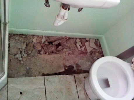 Waterproofing repairs to the foundation of a basement bathroom