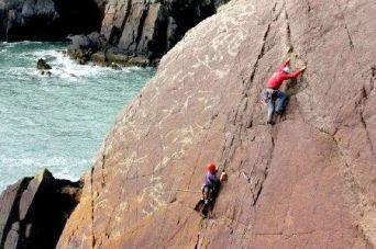 Rock climbing near St Davids and Solva, Pembrokeshire Coast National Park, South West Wales