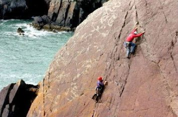 Rock climbing near St Davids and Solva, Pembrokeshire Coast National Park, South West Wales