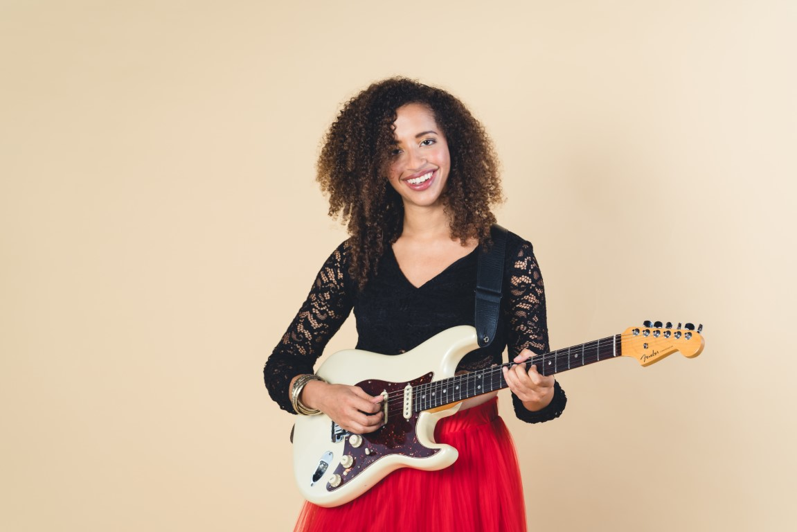 Austin blues guitarist Jackie Venson discusses her transition from piano to guitar, finding her voice as a blues guitarist, and her new album Joy