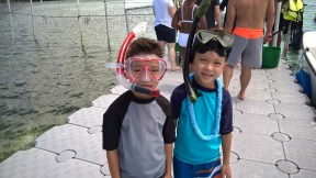 Boys getting ready to snorkel with stingrays!
