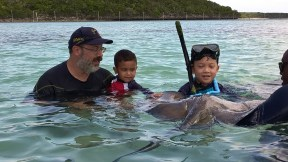 JJ holding a stingray and MJ getting brave petting