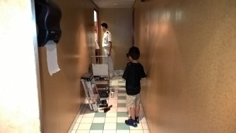 Right before disembarking, AJ got stuck in a bathroom stall with a broken lock. They had to break the door down!