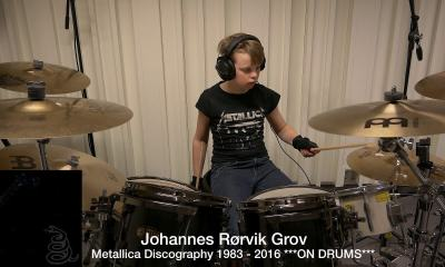 Kid playing Metallica on drums