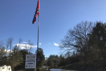 Flag flies in the face of zoning laws, county says
