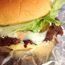 Mission Control Burger: Rocket Sauce, Raw Onion, Rocket-Made Sweet & Spicy Pickles, Lettuce.