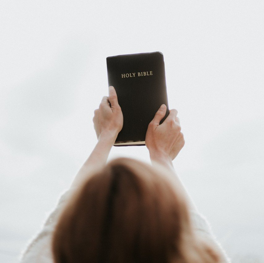 woman holding Bible up