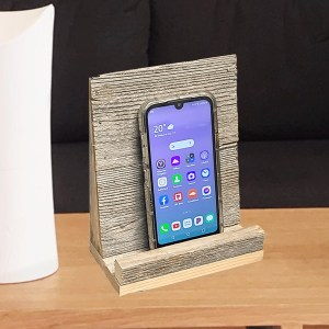 Mobile stand front with phone on table-1