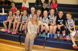 Head Girls Varsity Coach Ms. Mitchell  with the Grade 5 Travel Team at the January 27th game vs Norwell