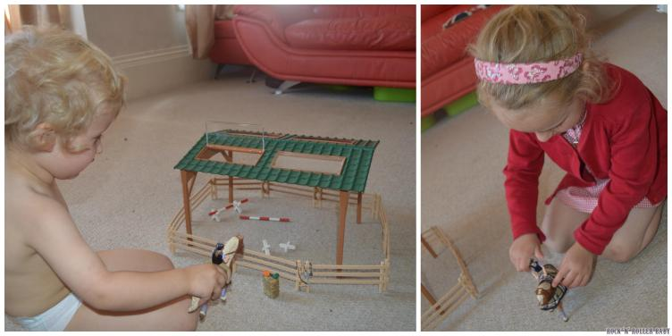 Florence and Jimmy having fun playing with the Schleich Riding Arena!