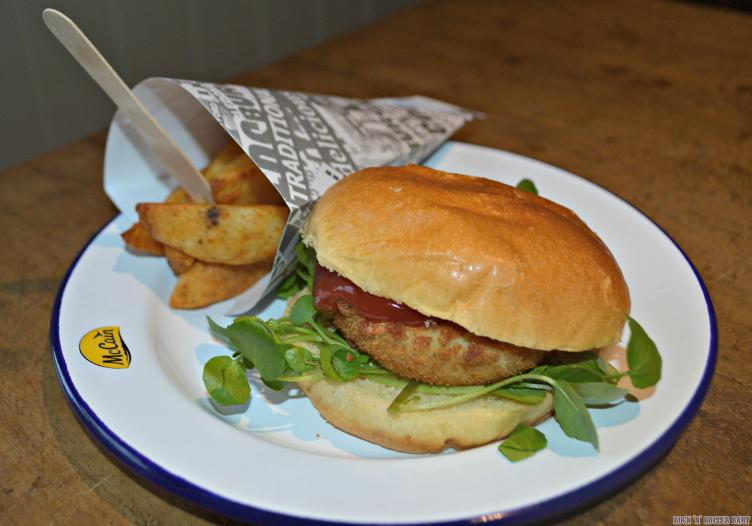 Fish burger with watercress in a brioche bun and served with McCain's Lightly Spiced Wedges!