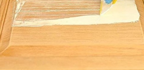 how to fill in wood grain on cabinets
