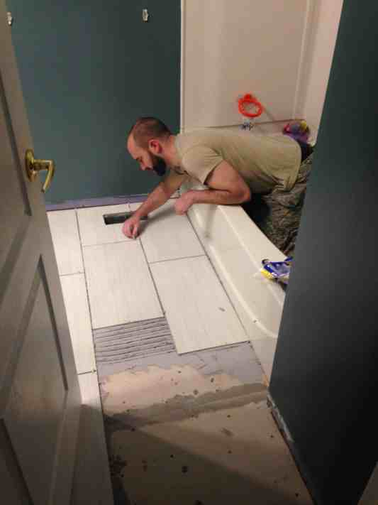 how to lay down tile in a bathroom