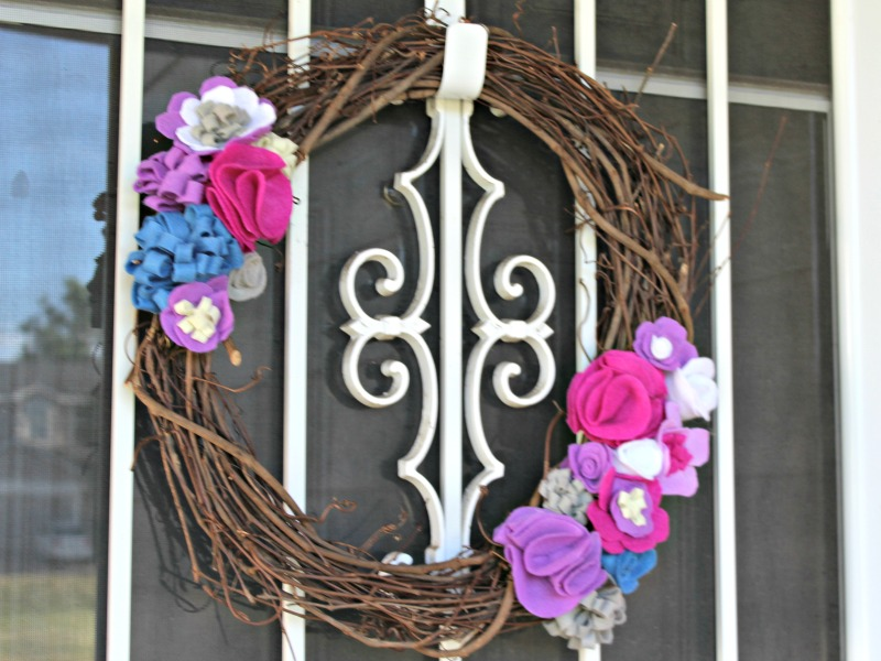 Making a felt flower wreath is a fun and easy way to add some cheer to your door decor!