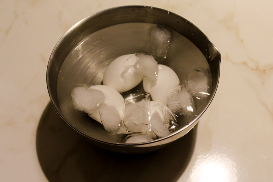 Cooling hard boiled eggs in ice water is the trick for creating perfectly peeled eggs.