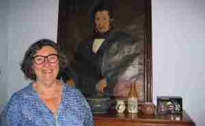 Photo of Alison Smith and a photo of her family heritage, a past relative